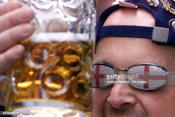 England football fan Steve Wright from Watford enjoys a beer in the Centre of Munich in Germany on the day England plays Germany in a World Cup...