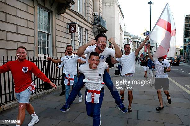 England football fans gear up to watch their team take on Italy in their opening match of the Football World Cup on June 14 2014 in London United...