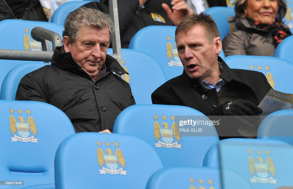 """England football manager Roy Hodgson (L) talks to England U21 manager Stuart Pearce (R) before the English Premier League football match between Manchester City and Manchester United at The Etihad stadium in Manchester, north-west England on December 9, 2012. USE. No use with unauthorized audio, video, data, fixture lists, club/league logos or """"live"""" services. Online in-match use limited to 45 images, no video emulation. No use in betting, games or single club/league/player publications."""
