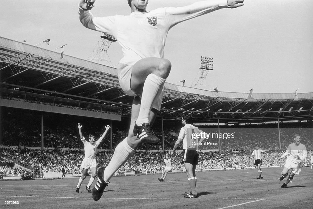 England football player <a gi-track='captionPersonalityLinkClicked' href=/galleries/search?phrase=Geoff+Hurst&family=editorial&specificpeople=206880 ng-click='$event.stopPropagation()'>Geoff Hurst</a> (foreground) jumps in jubilation after scoring England's winning goal against Argentina in the World Cup quarter final match at Wembley Stadium. On the left is Roger Hunt (arms raised) and on the right is <a gi-track='captionPersonalityLinkClicked' href=/galleries/search?phrase=Alan+Ball+-+World+Cup+Winner&family=editorial&specificpeople=213401 ng-click='$event.stopPropagation()'>Alan Ball</a>.