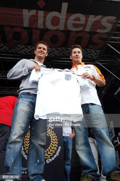 England football player Michael Owen and USA's moto GP rider Nicky Hayden hold up an England football shirt during a photocall at Donington Park...