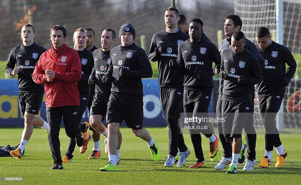 England football players train with coach Gary Neville (2nd L) during a training session at St George's Park in central England, on February 4, 2013. England take on Brazil at London's Wembley stadium in an international friendly on February 6. AFP PHOTO/Paul Ellis/ NOT