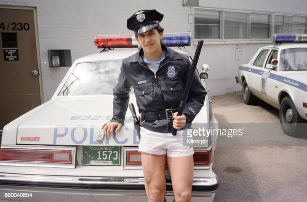 England football star Gary Lineker dressed in policeman's jacket and hat and holding a truncheon during a visit to a police station in Colorado...