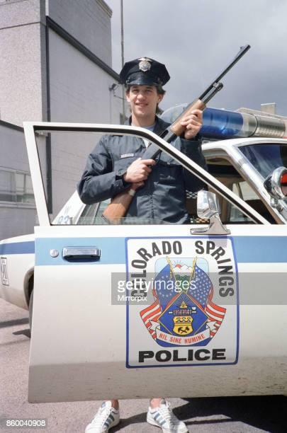 England football star Gary Lineker dressed in policeman's jacket and hat and holding a rifle during a visit to a police station in Colorado Springs...