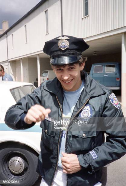 England football star Gary Lineker dressed in policeman's jacket and hat during a visit to a police station in Colorado Springs USA ahead of the 1986...