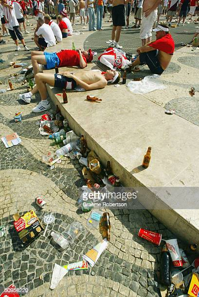 England football supporters sleep in Rossi Square surrounded by rubbish left from England fans drinking throughout the day on June 13 2004 Lisbon...
