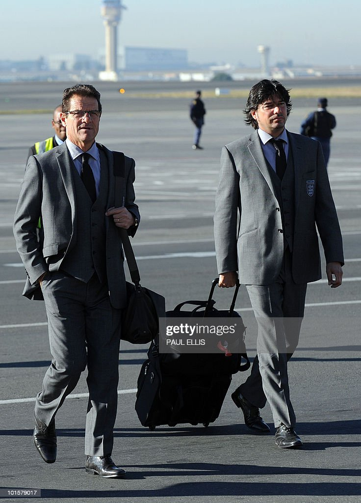 England football team coach Fabio Capello (L) from Italy arrives at Johannesburg Airport in South Africa for the 2010 Football World Cup Finals on June 03, 2010. The team will transfer to their hotel and training base at the Bafokeng Sports Campus near Rustenburg, ahead of their opening game against USA on June 12.