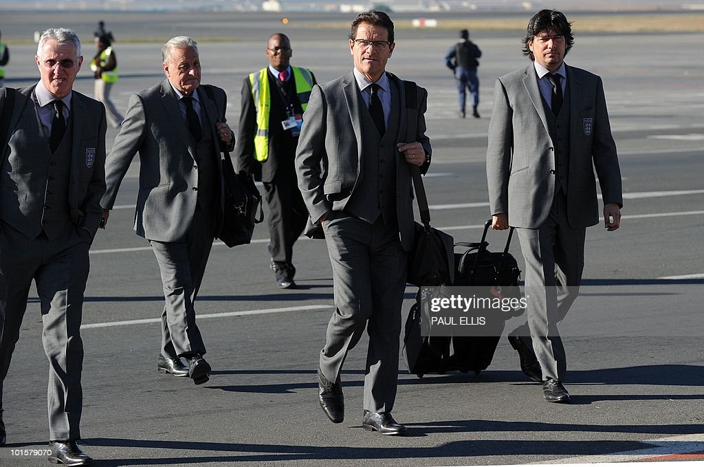 England football team coach Fabio Capello (2R) from Italy arrives at Johannesburg Airport in South Africa for the 2010 Football World Cup FInals on June 3, 2010. The team will transfer to their hotel and training base at the Bafokeng Sports Campus near Rustenburg, ahead of their opening game against USA on June 12.