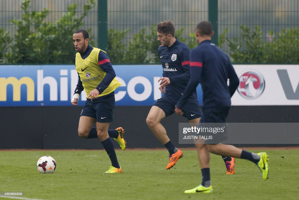 England football team player Andros Townsend runs with the ball during an England training session at Arsenal's training ground, London Colney, north of London on November 18, 2013 ahead of their forthcoming international friendly football match against Germany. AFP PHOTO / JUSTIN TALLIS - NOT FOR MARKETING OR ADVERTISING USE / RESTRICTED TO EDITORIAL USE