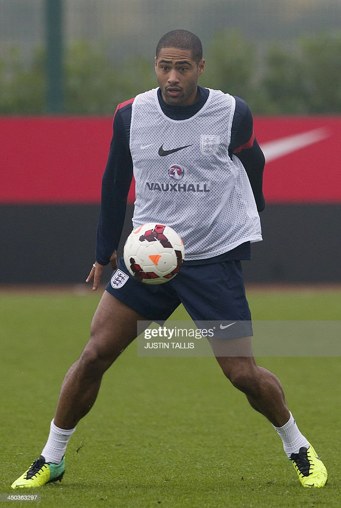 England football team player Glen Johnson takes part in an England training session at Arsenal's training ground, London Colney, north of London on November 18, 2013 ahead of their forthcoming international friendly football match against Germany.