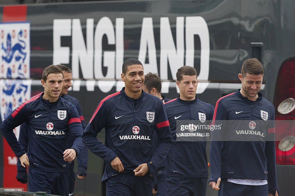 England football team players Jordan Henderson (L) Chris Smalling (2-L) and Gary Cahill (R) arrrive along with other members of the squad for an England training session at Arsenal's training ground, London Colney, north of London on November 18, 2013 ahead of their forthcoming international friendly football match against Germany.