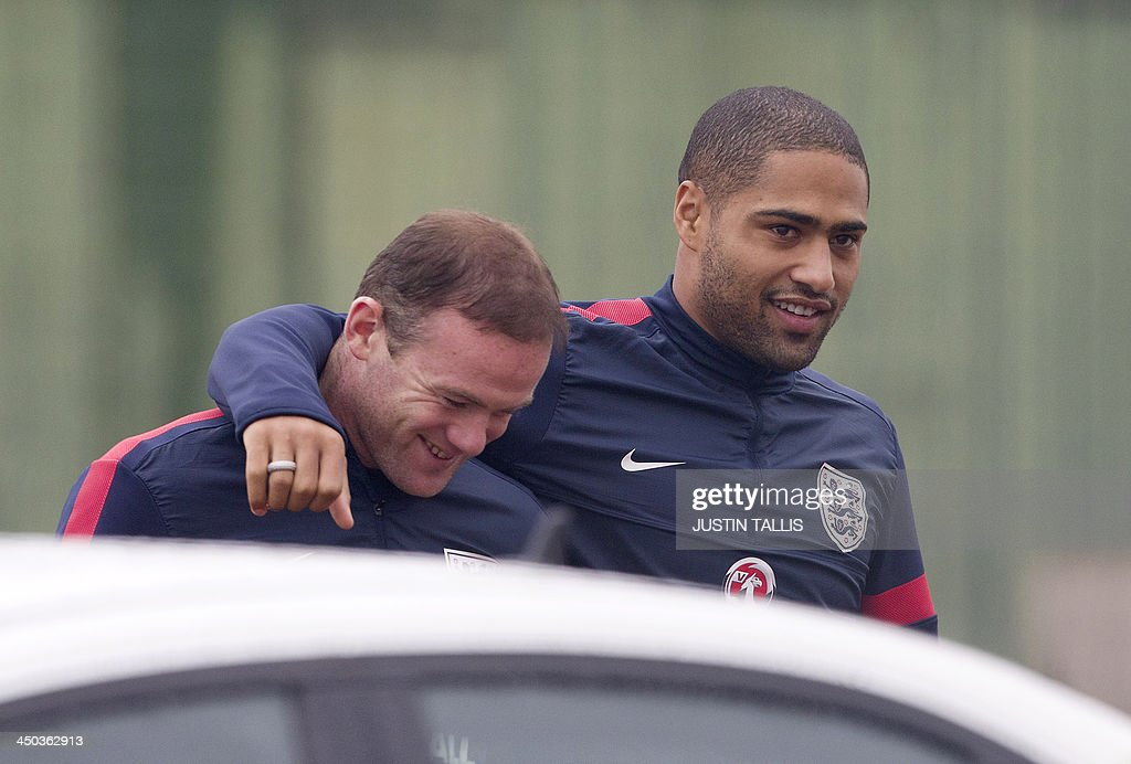 England football teamplayers Wayne Rooney (L) and Glen Johnson (R) arrrive for an England training session at Arsenal's training ground, London Colney, north of London on November 18, 2013 ahead of their forthcoming international friendly football match against Germany.