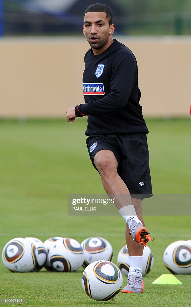 England footballer Aaron Lennon kicks a ball during a training session of the English national football team in Irdning, Austria on May 19, 2010 ahead of the World Cup Finals in South Africa. The English football team arrived in Austria on May 17 for a training camp at altitude ahead of the World Cup.