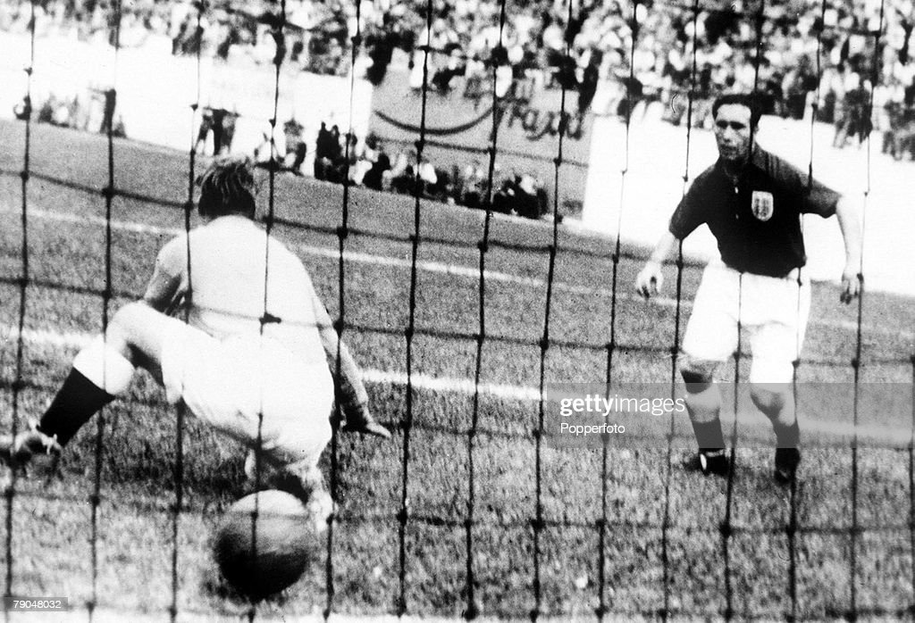 England footballer Alf Ramsey (1920 – 1999, right) watches as goalkeeper Bert Williams is beaten by a shot from Joe Gaetjens of the USA in the 38th minute of a group 2 match in the World Cup Finals, at the Estadio Independencia, Belo Horizonte, Brazil, 29th June 1950. Gaetjens' goal gave the USA a sensational 1-0 victory