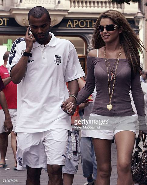 England footballer Ashley Cole and his partner singer Cheryl Tweedy of Girls Aloud walk to the shops on June 26 2006 in BadenBaden Germany England...