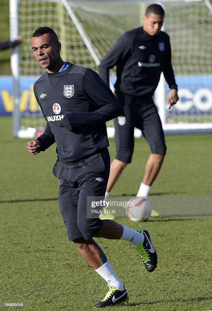 England footballer Ashley Cole takes part in a team training session at St George's Park in central England, on February 4, 2013. England take on Brazil at London's Wembley stadium in an international friendly on February 6. AFP PHOTO/Paul Ellis USE
