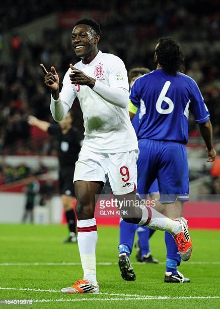 England footballer Danny Welbeck celebrates scoring the second goal during the World Cup 2014 group H qualifying football match against San Marino at...
