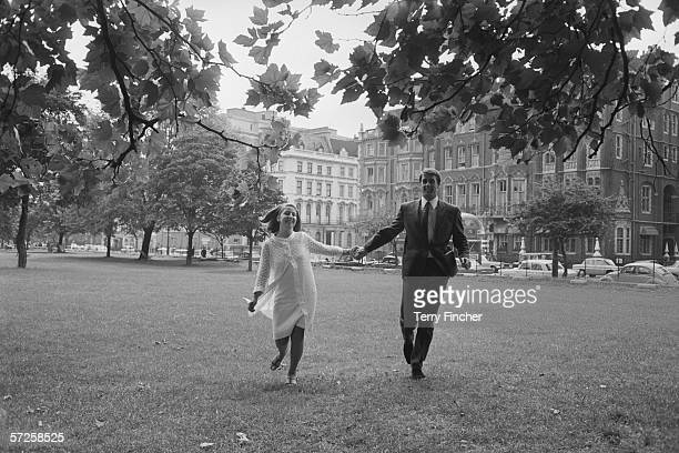 England footballer Geoff Hurst and his wife Judith on their way to the Royal Garden Hotel in Kensington for a reception held to celebrate the World...