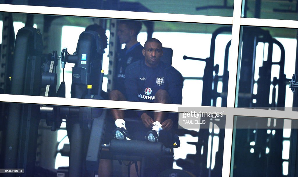 England footballer Jermaine Defoe works out in the gym during a training session at the St George's Park training complex, near Burton-upon-Trent, central England on March 19, 2013 ahead of their 2014 World Cup qualifier football match against San Marino on March 22.