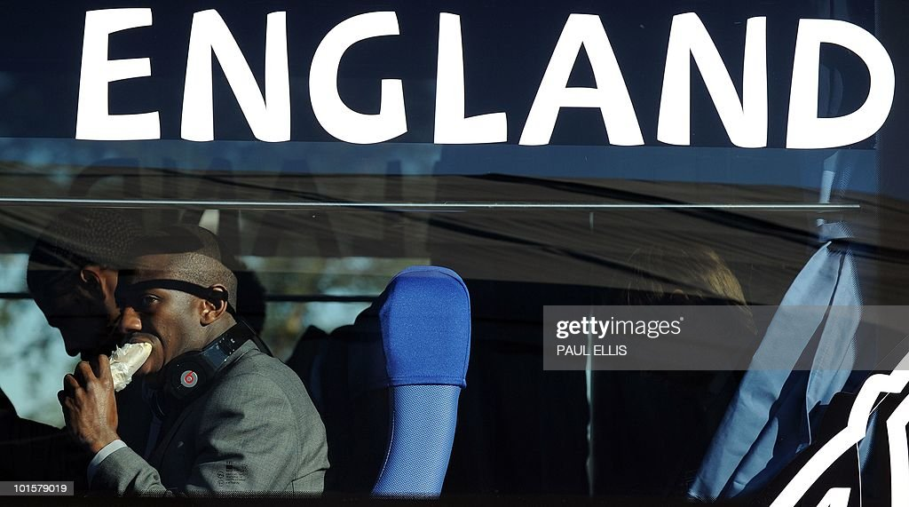 England footballer Shaun Wright-Phillips eats as he sits in the team bus at Johannesburg Airport in South Africa for the 2010 Football World Cup Finals on June 3, 2010. The team will transfer to their hotel and training base at the Bafokeng Sports Campus near Rustenburg, ahead of their opening game against USA on June 12.