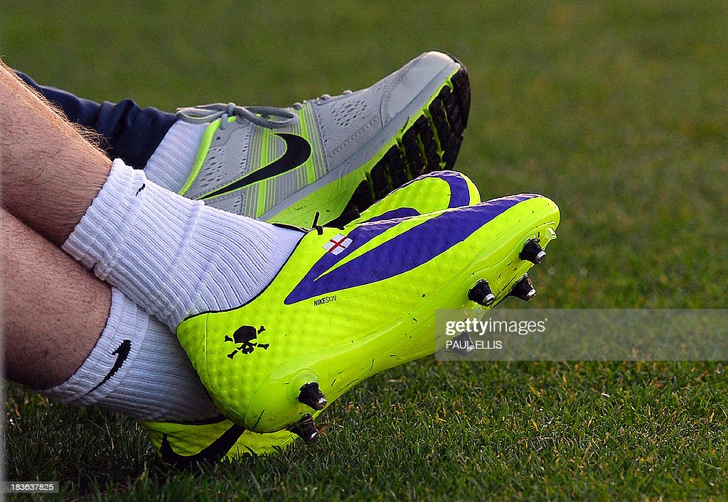 England footballer Wayne Rooney's boots (foreground) are pictured featuring a Skull and Crossbones during a team training session at the St George's Park training complex, near Burton-upon-Trent in central England, on October 8, 2013. England face Montenegro at Wembley in a 2014 World Cup qualifier on October 11, 2013. AFP PHOTO/Paul Ellis USE