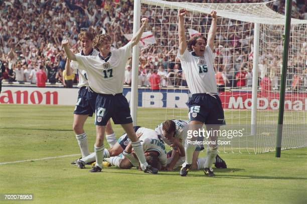 England footballers celebrate after Paul Gascoigne scored the winning goal against Scotland in the UEFA Euro 1996 Group A match between England and...