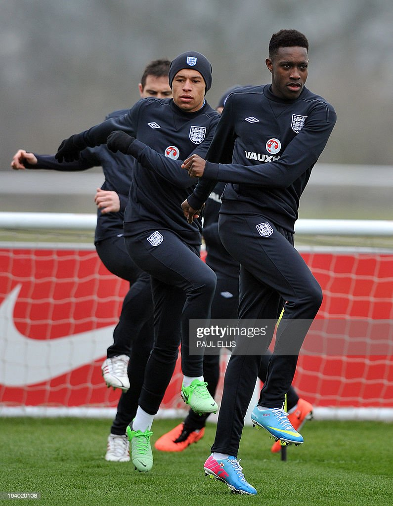 England footballers Danny Welbeck (R) and Alex Oxlade-Chamberlain take part in a training session at the St George's Park training complex, near Burton-upon-Trent, central England on March 19, 2013 ahead of their 2014 World Cup qualifier football match against San Marino on March 22.
