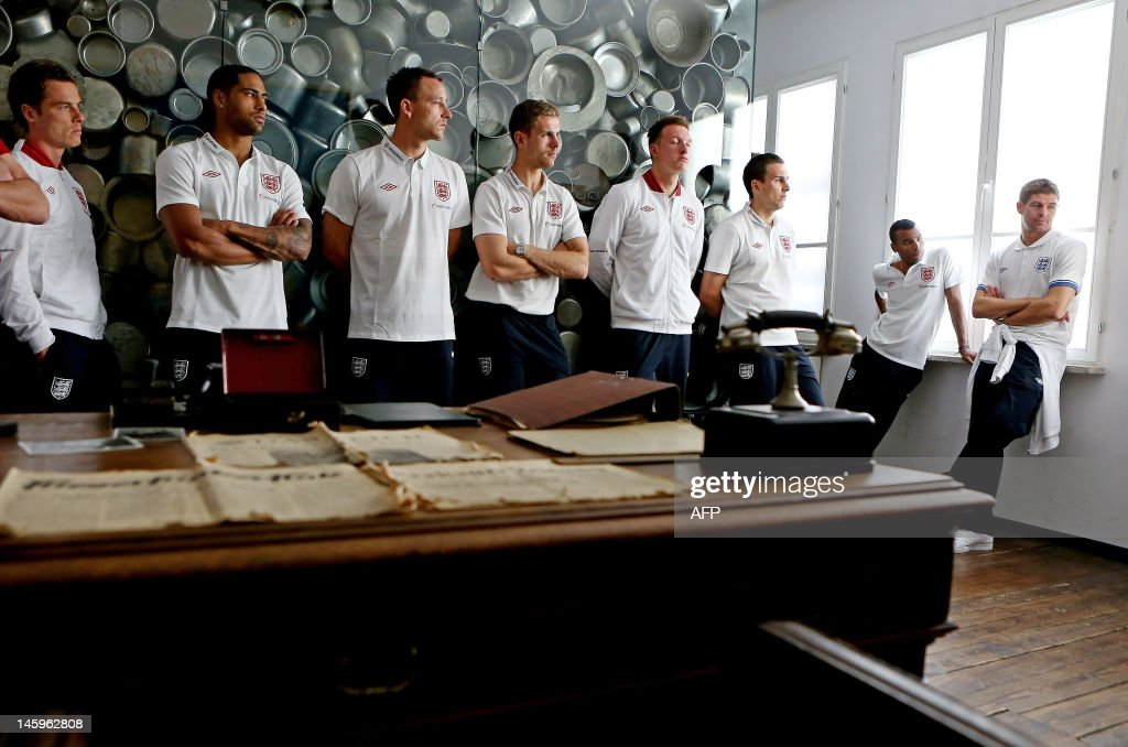 England footballers Scott Parker, (L) Glen Johnson, (2nd L) John Terry, (3rd L) Jordan Henderson, (4th L) Phil Jones, (4th R) Stewart Downing, (3rd R) Ashley Cole (2nd R) and Steven Gerrard (R) visit the Schindler Factory in Oswiecim in Poland, on June 8, 2012. England enjoyed a low-key public training session on Friday as they prepared to open their Euro 2012 campaign against France on Monday June 11, 2012. AFP PHOTO / Scott Heavey/POOL