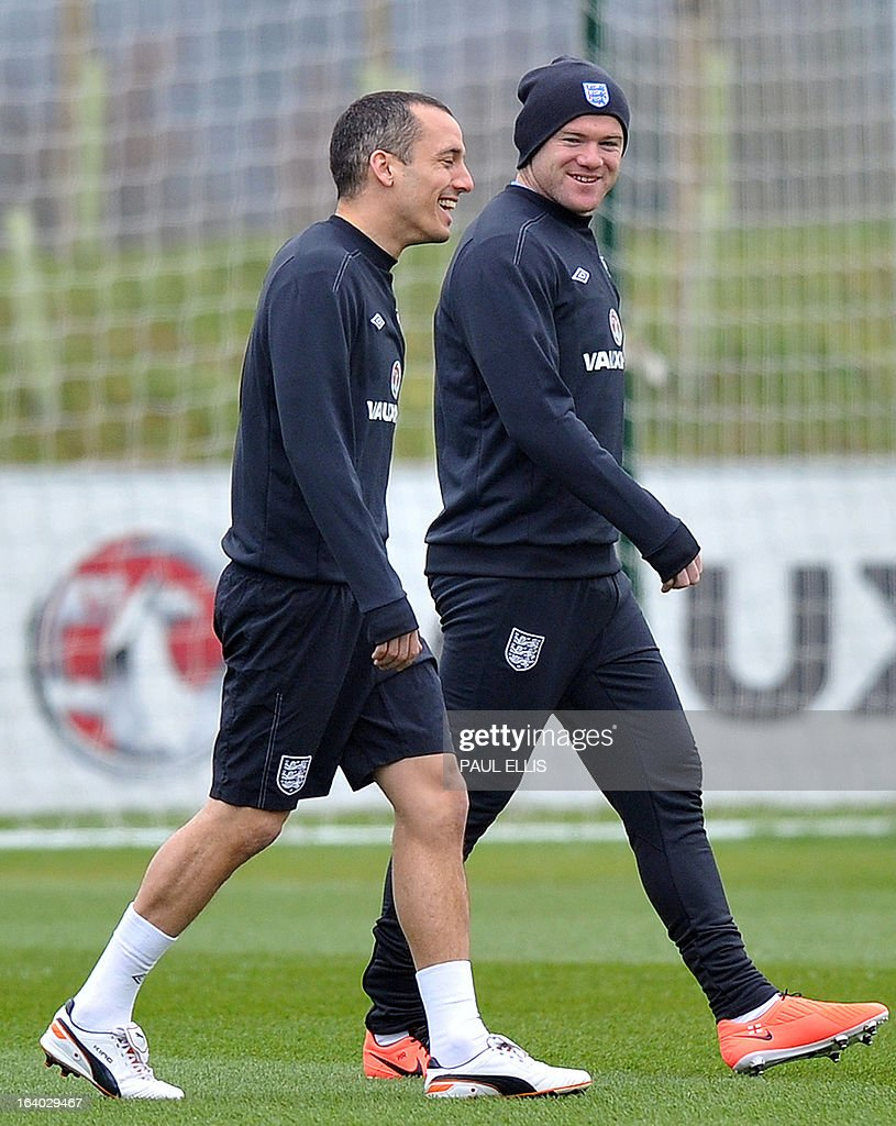 England footballers Wayne Rooney (R) and Leon Osman (L) arrive for a training session at the St George's Park training complex, near Burton-upon-Trent, central England on March 19, 2013 ahead of their 2014 World Cup qualifier football match against San Marino on March 22.