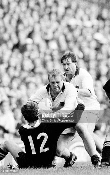 England forward Dean Richards has Mike Teague in support as he is tackled by Bernie McCahill of New Zealand during the Rugby Union World Cup match...