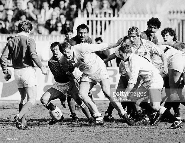England forward Dean Richards holds off France scrumhalf Pierre Berbizier during the Rugby Union International match at the Parc des Princes in Paris...