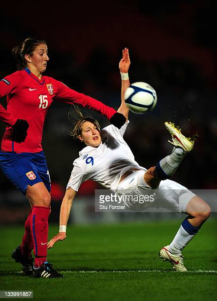 England forward Ellen White gets in a shot watched by Serbia defender Violeta Slovic during the UEFA Women's Euro 2013 qualifier between England and...