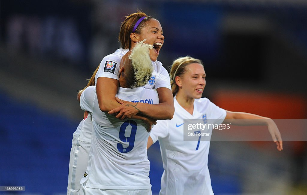 England forward Lianne Sanderson celebrates with Alex Scott and Jordan Nobbs after scoring the fourth England goal during the FIFA 2015 Women's World...
