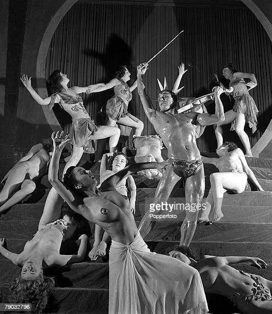 England French dance troupe Les Folies Bergere bring their show to London Several topless dancers writhe provocatively on stage