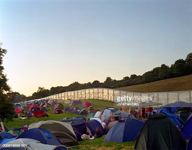 UK, England, Glastonbury, tents in field at music festival, dawn
