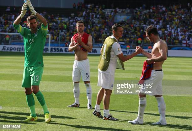 England goalkeeper Ben Foster Gary Cahill Phil Jagielka and Frank Lampard applaud the travelling fans after the match