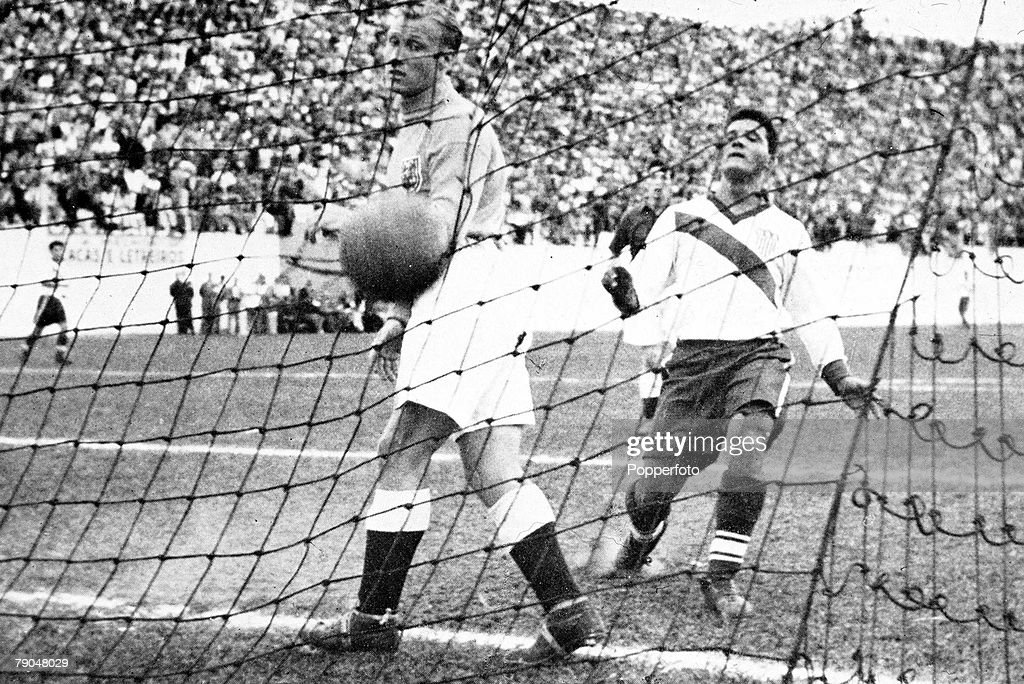 England goalkeeper <a gi-track='captionPersonalityLinkClicked' href=/galleries/search?phrase=Bert+Williams+-+Soccer+Player&family=editorial&specificpeople=4617316 ng-click='$event.stopPropagation()'>Bert Williams</a> (left) and Haitian American soccer player Joe Gaetjens (1924 - 1964) of the US team, in a group 2 match at the Estadio Independencia, Belo Horizonte, Brazil, 29th June 1950. Gaetjens scored a goal in the 38th minute, giving the USA a sensational victory.