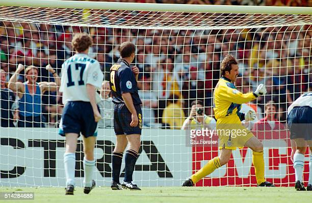 England goalkeeper David Seaman celebrates after saving the penalty from Gary McAllister during the 1996 European Championships group stage match...