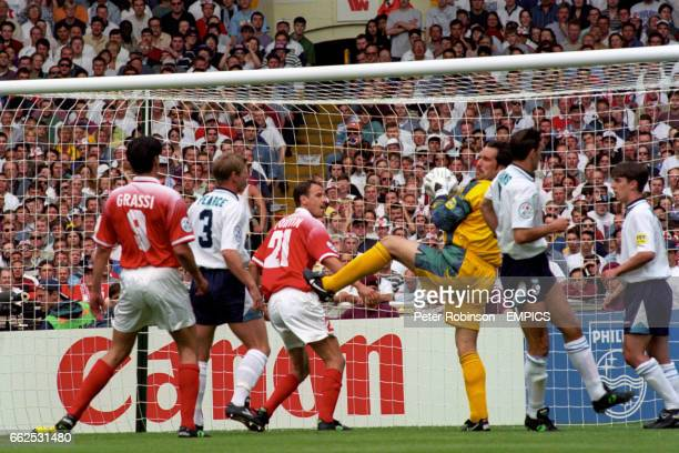 England goalkeeper David Seaman collects the ball from a cross under pressure from Switzerland's Marco Grassi and Christophe Bonvin and team mates...