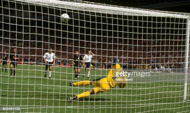 England goalkeeper David Seaman saves a penalty from Scotland player Gary McAllister during the 1996 European Championships match between England and...