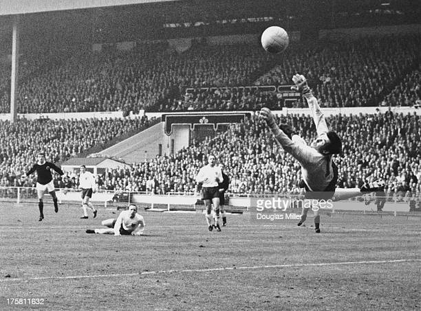 England goalkeeper Gordon Banks saves a shot from Denis Law during an England V Scotland match at Wembley London while Nobby Stiles looks on from the...