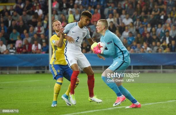 England goalkeeper Jordan Pickford and teammate Mason Holgate deny Gustav Engvall of Sweden during their UEFA European Under21 Championship match...