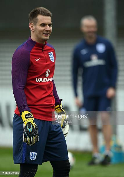 England goalkeeper Tom Heaton participates in a team training session at St George's Park in BurtononTrent central England on March 22 2016 England...