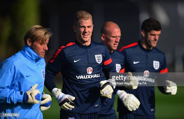 England goalkeeping coach Dave Watson warms up with Joe Hart John Ruddy and Fraser Forster during the England training session at London Colney on...