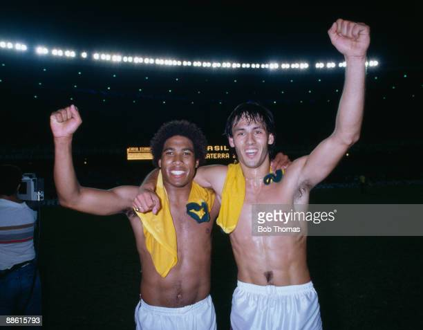 England goalscorers John Barnes and Mark Hateley celebrate at the end of the International friendly between Brazil and England at the Maracana...
