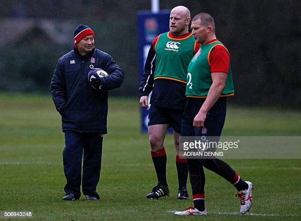 England head coach Eddie Jones watches as captain Dylan Hartley and prop Dan Coles take part in a training session at their Pennyhill Park factility...