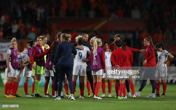 England head coach Mark Sampson comforts his players following the UEFA Women's Euro 2017 Semi Final match between Netherlands and England at De...