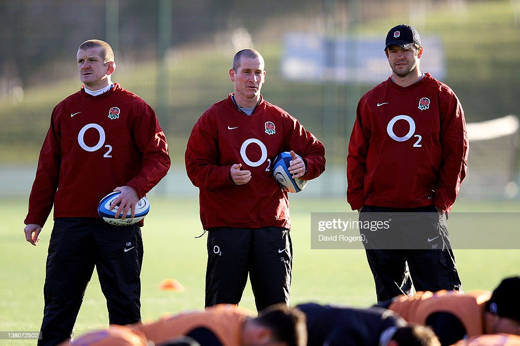 England head coach <a gi-track='captionPersonalityLinkClicked' href=/galleries/search?phrase=Stuart+Lancaster&family=editorial&specificpeople=2263180 ng-click='$event.stopPropagation()'>Stuart Lancaster</a> (C) and his assistant coaches <a gi-track='captionPersonalityLinkClicked' href=/galleries/search?phrase=Graham+Rowntree&family=editorial&specificpeople=215047 ng-click='$event.stopPropagation()'>Graham Rowntree</a> (L) and <a gi-track='captionPersonalityLinkClicked' href=/galleries/search?phrase=Andy+Farrell+-+Rugby+Coach&family=editorial&specificpeople=234823 ng-click='$event.stopPropagation()'>Andy Farrell</a> (R) watch over their players during the England training session at Surrey Sports Park on February 2, 2012 in Guildford, England.