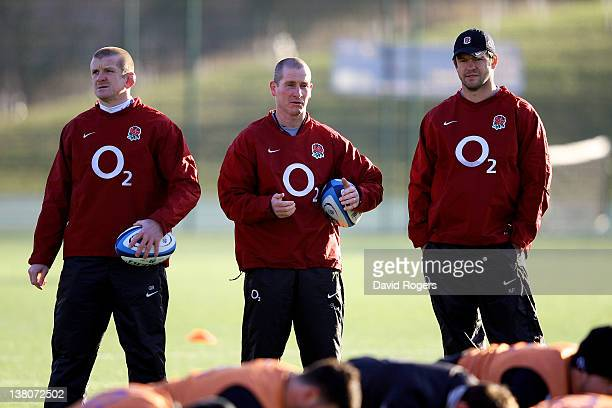 England head coach Stuart Lancaster and his assistant coaches Graham Rowntree and Andy Farrell watch over their players during the England training...