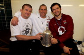 England head coach Stuart Lancaster and his assistant coaches Graham Rowntree and Andy Farrell pose with the Calcutta Cup following their team's 136...